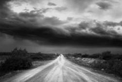 Black and white image of a dirt road, representing the road travelled in trauma - get trauma counselling at C&C Resources for Life